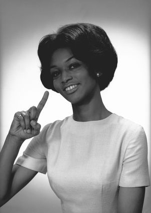 Retro-woman-finger-pointing-up