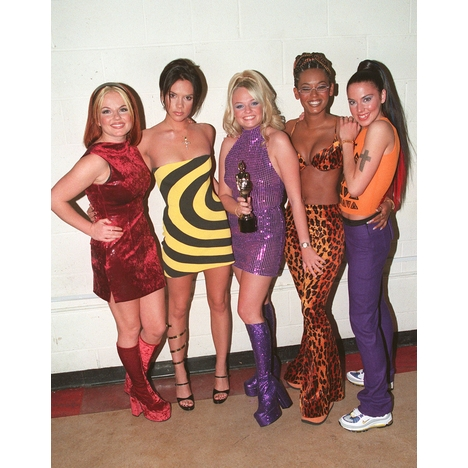 "Back in 1995, Victoria ""Posh Spice"" wore a black and yellow mini dress and"