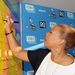 Queen-latifah-writes-messages-of-positivity-on-the-post-it-brand-wall-in-support-of-dosomething