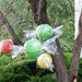 Paper lanterns wrapped in plastic hung from the trees, resembling pieces of candy.