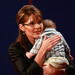 Republican Sarah Palin holds her infant son Trig following her vice presidential debate with Democrat Joseph Biden October 2, 2008 at Washington University in St. Louis, Missouri.