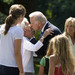 Senator Joe Biden kisses his mother, Jean, outside his Delaware home. Senator Biden's wife Jill watches the sweet moment.