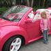 In front of Barbie's car