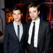 Actors Taylor Lautner (L) and Robert Pattinson arrive at the afterparty for the premiere of Summit Entertainment's 'The Twilight Saga: New Moon' at the Hammer Museum on November 16, 2009 in Los Angeles, California.